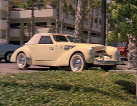 "Background scene of a 1969 Cord Warrior from the 1987 movie ""Like Father, Like Son"" starring Dudley Moore and Kirk Cameron."
